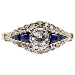 18 Karat Gold and Platinum Diamonds and Sapphires Ring