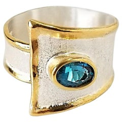 Yianni Creations 1.60 Carat Blue Topaz Ring in Fine Silver 24 Karat Gold