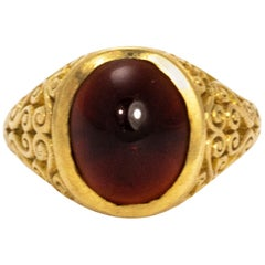 Edwardian Garnet Cab and 9 Carat Gold Ring