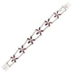 Ruby and Diamond Flower Bracelet in White Gold