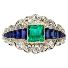 Unique Platinum Emerald, Sapphires and Diamonds Ring