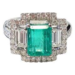 Emerald and White Diamond Ring in 18 Karat White Gold
