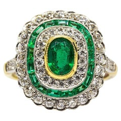 Sparkling 18 Karat Gold and Platinum Diamonds and Emeralds Ring