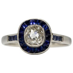 Glowing Platinum Diamond and Sapphires Halo Ring