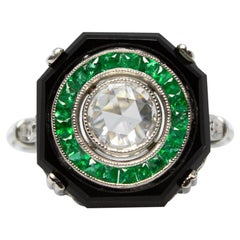 Luxurious Platinum Diamond, Onyx and Emerald Halo Ring