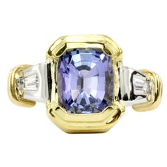 Platinum and Yellow Gold Tanzanite and Diamond Baguette Ring