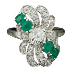 Diamond and Emerald Ring in Platinum, circa 1930s