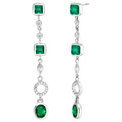 Emerald and Diamond Drop Gold Earrings Two Inch Long