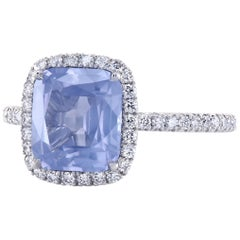 GIA Certified Color Change Milky Blue Spinel Platinum Halo Ring