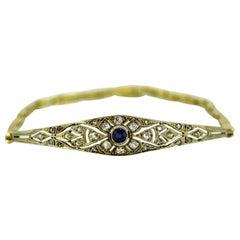 Art Deco 18 Karat Gold Bracelet / Bangle with Blue Sapphire and Diamonds, 1920s