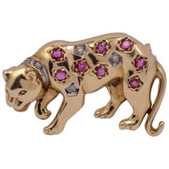 Vintage Ruby Diamond Leopard Brooch 9 Karat Yellow Gold, circa 1960s