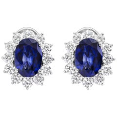 Oval Cut Blue Sapphire and Diamond Halo Omega Clip Earrings