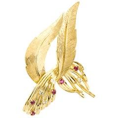 14 Karat Yellow Gold Five Rubies and Four Diamonds Curvy Leaf Pin