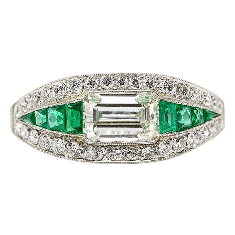 Estate Platinum Art Deco Old Mine Cut Diamond and Emerald Cut Ring with Emeralds