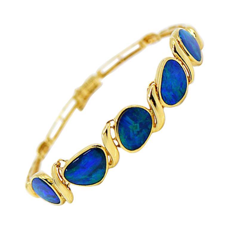 Lightning Ridge Black Opal Sectional Bracelet 14 Karat Yellow Gold For Sale
