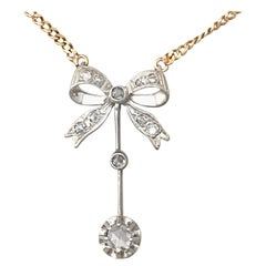 Antique Diamond and White Gold Bow Pendant Circa 1920