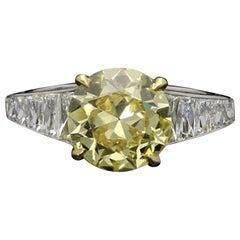 Hancocks 2.41 Carat Fancy Intense Yellow Diamond Ring with French-Cut Shoulders