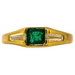 Art Deco 0.55 Carat Emerald 0.70 Carat White Baguette Diamond Yellow Gold Ring