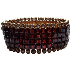 Gold Diamond Garnet Invisible Set Bracelet, H. J. Wilm