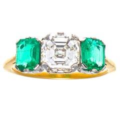 Art Deco GIA 1.52 Carat Diamond and Emerald Gold and Platinum Ring