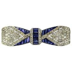Art Deco Platinum Bow-Tie Brooch, Blue Sapphires and Diamonds, circa 1920s