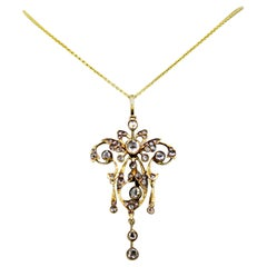Victorian 15k gold pendant with diamonds, with a 14k gold modern necklace