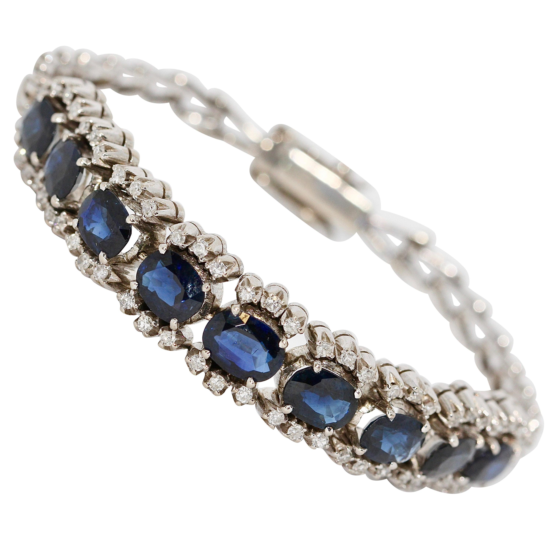 18 Karat White Gold Tennis Bracelet with Natural Blue Sapphires and Diamonds