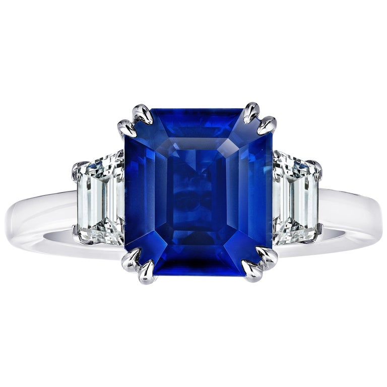4.86 Carat Emerald Cut Blue Sapphire and Diamond Ring For Sale