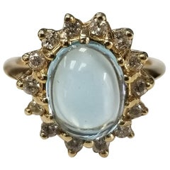 Blue Topaz Cabochon and Diamond Ring