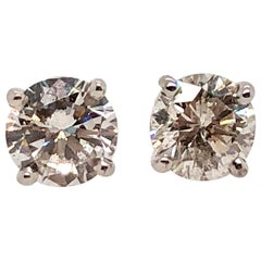 0.84 Carat Round Cut Diamond and White Gold Diamond Stud Earrings