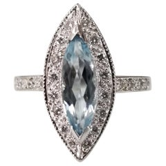 14 Karat White Gold Blue Topaz Marquise Cut and Diamond Ring
