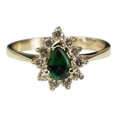 14 Karat Yellow Gold Green Tourmaline and Diamond Ring
