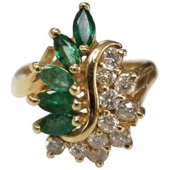 14 Karat Yellow Gold Emerald and Diamond Cluster Ring