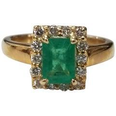 14 Karat Yellow Gold Emerald Cut Emerald and Diamond Ring