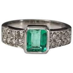 14 Karat White Gold Emerald Cut Emerald and Diamond Ring