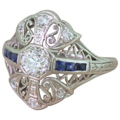 Art Deco 0.65 Carat Old Cut Diamond and Sapphire Platinum Ring