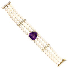 18 Karat Three-Strand Pearl Bracelet with Amethyst and Diamond Center
