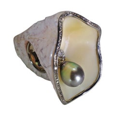 18 Karat White Gold Carved Abalone Shell Ring with Tahitian Pearl and Diamonds