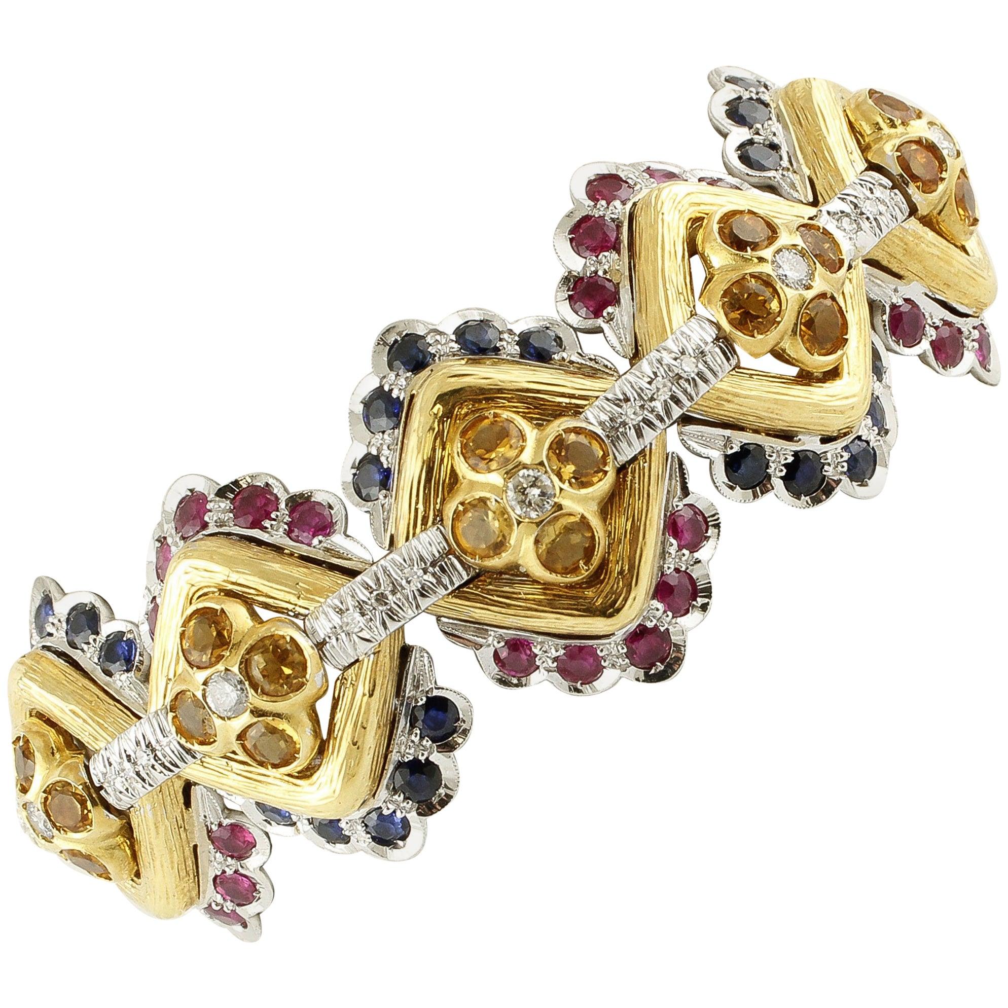White Diamonds, Blue Sapphires, Rubies White and Yellow Gold Link Bracelet