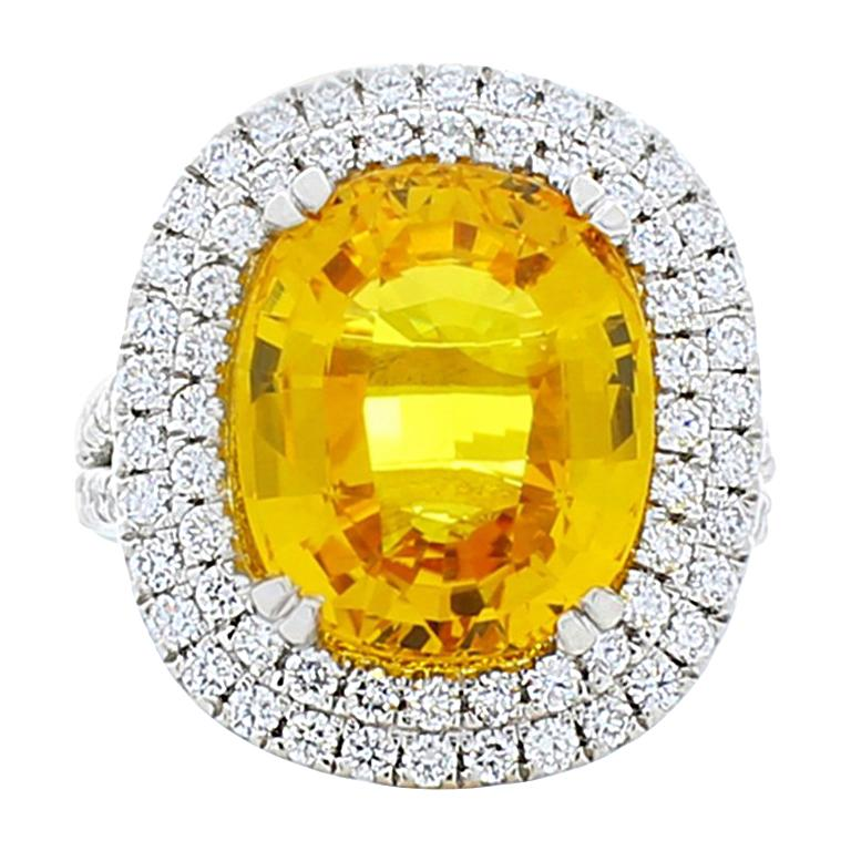 fdf17f40794ab 10.90 Carat Oval Yellow Sapphire and Diamond Cocktail Ring in Platinum