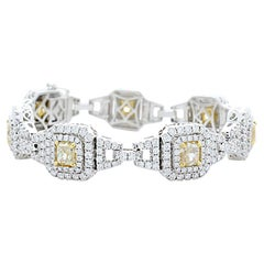 EGL USA Certified 7.73 Carat Total Cushion Cut Yellow Diamond Bracelet In 18K