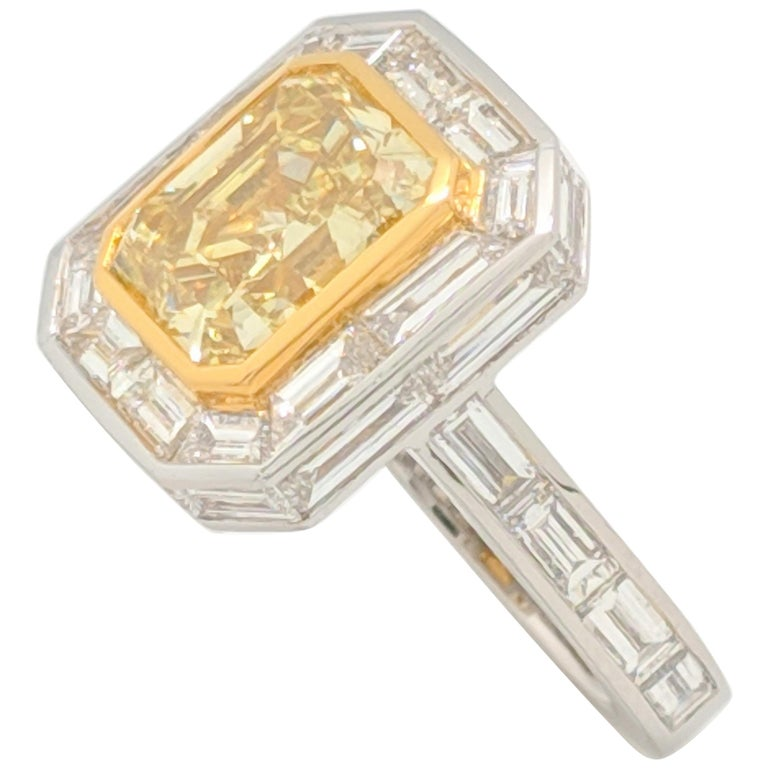 GIA 5.01 Carat Natural Fancy Yellow Emerald Cut Diamond Engagement Ring Platinum For Sale