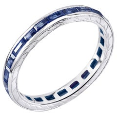 Eighteen Karat Gold Baguette Sapphire Eternity Engraved Band Weighing 1.65 Carat