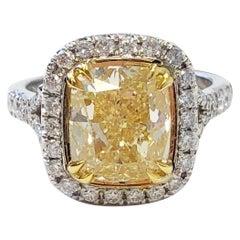 GIA Fancy Yellow Cushion Diamond and White Diamond Round Engagement Ring