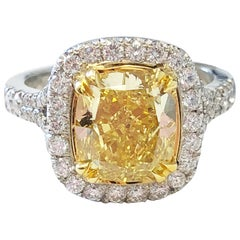 GIA Fancy Vivid Yellow Cushion Diamond Engagement Ring in Platinum and 18 Karat