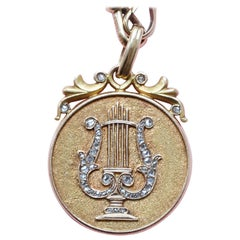 Gold and Diamond Lyre Pendant