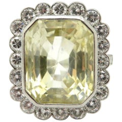 Platinum AGL Certified 17.00 Carat Yellow Sapphire and Diamond Halo Ring
