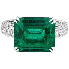 Natural 7.29 Carat Green Emerald 18 Karat White Gold Cocktail Diamond Ring