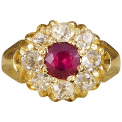 Late Victorian Ring with 0.70 Carat Ruby and Diamond Cluster in 18 Carat Gold