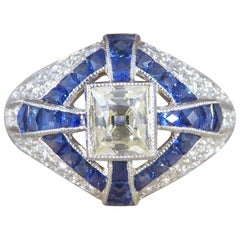 Contemporary Lemon Tinted Diamond and French Cut Sapphire Cross Ring in Platinum